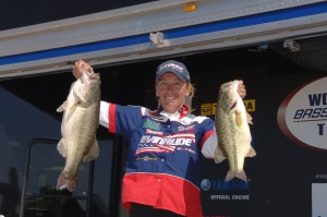 Kim Bain-Moore shows off her catch during weigh-in at last year's Women's Bassmaster Tour event in Lewisville, Texas.