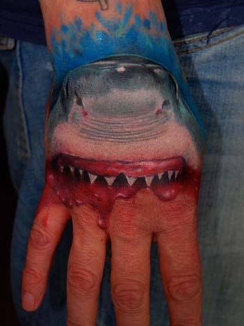 shark tattoo designs. I really love hand tattoos,